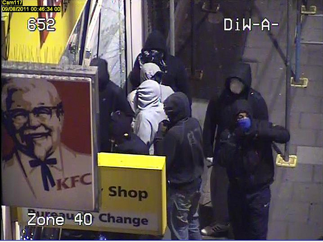 Suspected looters outside shop in South London